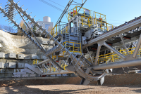 The rakes and bucket wheel remove material uniformly from the pile. (Source: SBM Mineral Processing)